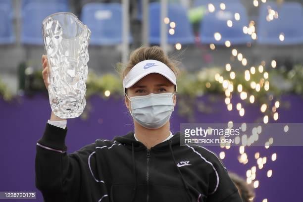 Ukraine's Elina Svitolina celebrates with her trophy after defeating Kazakhstan's Elena Rybakina in the final match of the WTA international open...