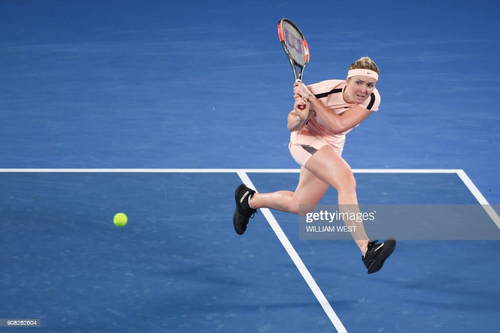 TOPSHOT - Ukraine's Elina Svitolina hits a return against Czech Republic's Denisa Allertova during their women's singles fourth round match on day seven of the Australian Open tennis tournament in Melbourne early January 22, 2018. /