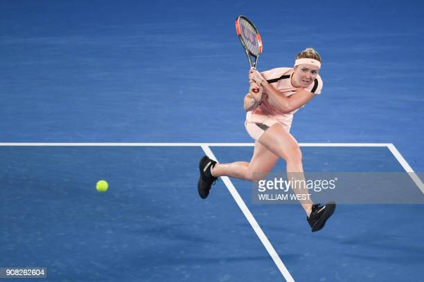 TOPSHOT Ukraine's Elina Svitolina hits a return against Czech Republic's Denisa Allertova during their women's singles fourth round match on day...