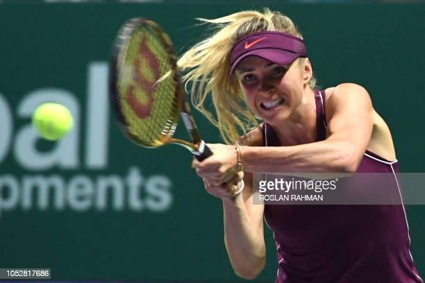 Ukraine's Elina Svitolina hits a return against Czech Republic's Karolina Pliskova during their singles match at the WTA Finals tennis tournament in...