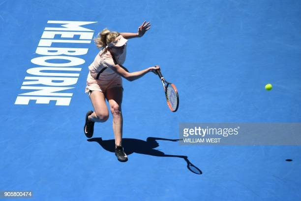 Ukraine's Elina Svitolina hits a return against Czech Republic's Katerina Siniakova during their women's singles second round match on day three of...