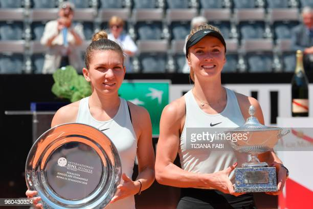 Ukraine's Elina Svitolina holds the trophy next to Romania's Simona Halep after winning the women's final at Rome's WTA Tennis Open tournament at the...