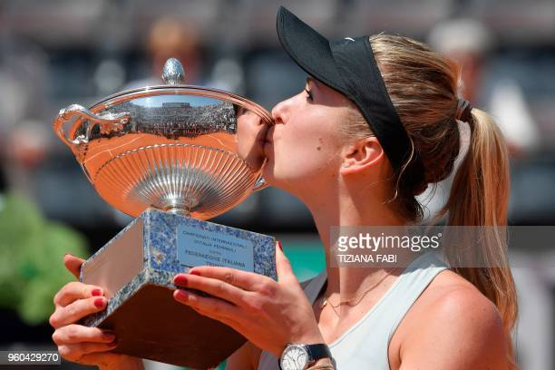 TOPSHOT Ukraine's Elina Svitolina kisses the trophy after winning the women's final against Romania's Simona Halep at Rome's WTA Tennis Open...