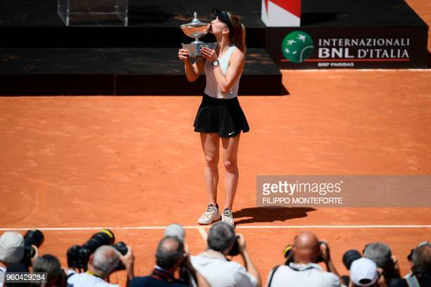 Ukraine's Elina Svitolina kisses the trophy after winning the women's final against Romania's Simona Halep at Rome's WTA Tennis Open tournament at...