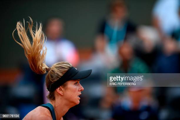 Ukraine's Elina Svitolina plays a forehand return to Romania's Mihaela Buzarnescu during their women's singles third round match on day six of The...