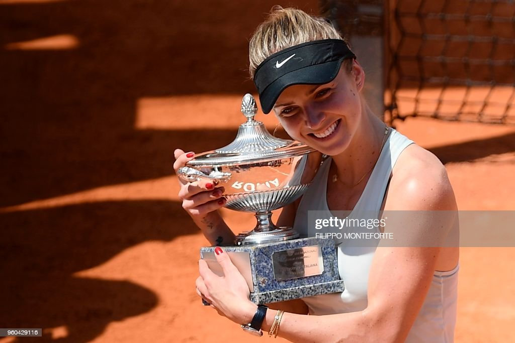 Ukraine's Elina Svitolina poses with the trophy after winning the women's final against Romania's Simona Halep at Rome's WTA Tennis Open tournament at the Foro Italico, on May 20, 2018 in Rome.