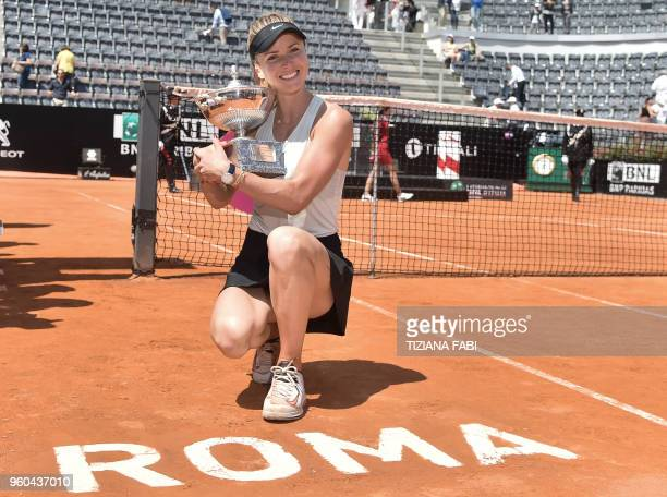 TOPSHOT Ukraine's Elina Svitolina poses with the trophy after winning the women's final against Romania's Simona Halep at Rome's WTA Tennis Open...