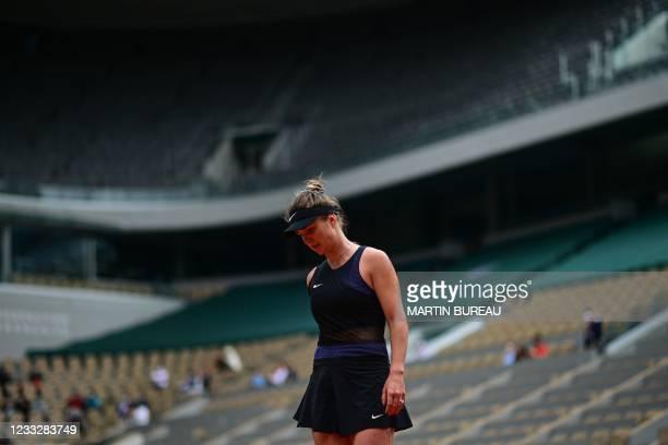 Ukraine's Elina Svitolina reacts as she plays against Czech Republic's Barbora Krejcikova during their women's singles third round tennis match on...
