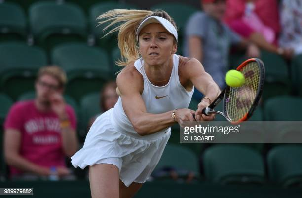 Ukraine's Elina Svitolina returns against Germany's Tatjana Maria during their women's singles first round match on the first day of the 2018...