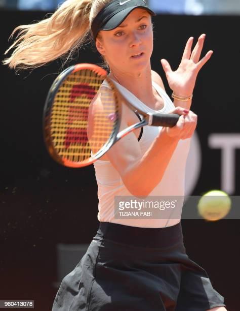 Ukraine's Elina Svitolina returns the ball to Romania's Simona Halep during the women's final at Rome's WTA Tennis Open tournament at the Foro...