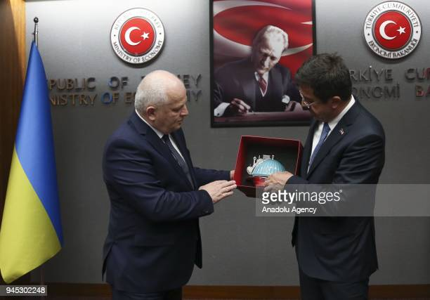 Ukraine's First Vice Prime Minister and Economy Minister Stepan Kubiv receives a present from Turkish Economy Minister Nihat Zeybekci after their...