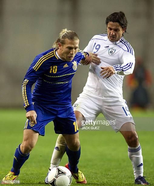 Ukraine's forward Andriy Voronin challenges Israel's defender Dedi Ben Dayan during their international friendly football match at Ha Moshava Stadium...