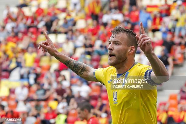 Ukraine's forward Andriy Yarmolenko celebrates scoring the opening goal during the UEFA EURO 2020 Group C football match between Ukraine and North...