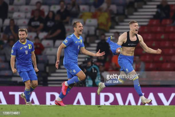 Ukraine's forward Artem Dovbyk celebrates scoring their second goal during the UEFA EURO 2020 round of 16 football match between Sweden and Ukraine...
