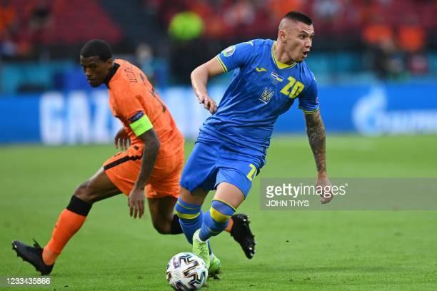 Ukraine's forward Oleksandr Zubkov dribbles past Netherlands' midfielder Georginio Wijnaldum during the UEFA EURO 2020 Group C football match between...