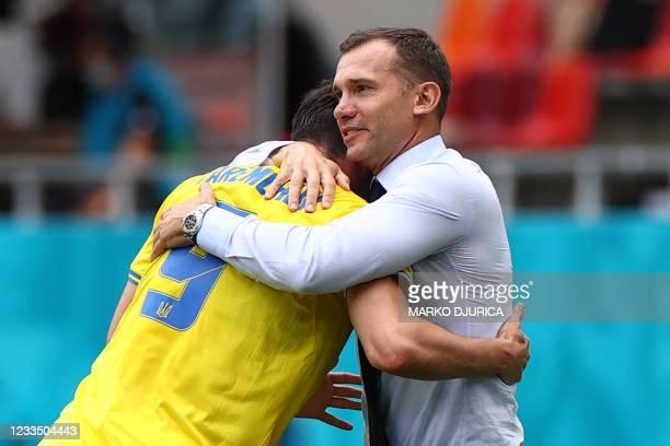 Ukraine's forward Roman Yaremchuk celebrates with Ukraine's coach Andrey Shevchenko after scoring his team's second goal during the UEFA EURO 2020...