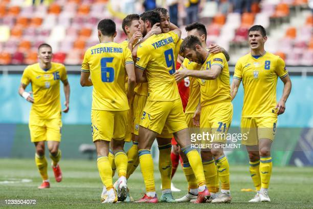 Ukraine's forward Roman Yaremchuk celebrates with Ukraine's forward Andriy Yarmolenko after scoring his team's second goal during the UEFA EURO 2020...
