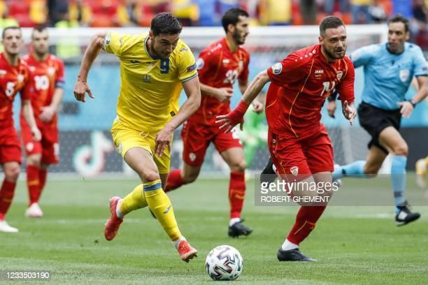 Ukraine's forward Roman Yaremchuk fights for the ball with North Macedonia's defender Darko Velkovski during the UEFA EURO 2020 Group C football...