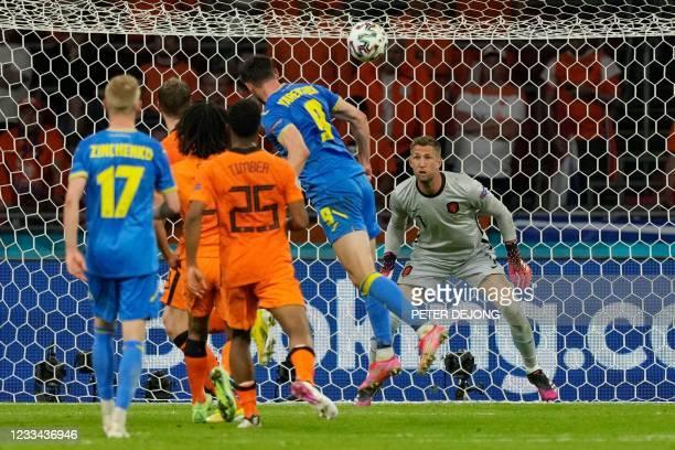 Ukraine's forward Roman Yaremchuk heads the ball to score past Netherlands' goalkeeper Maarten Stekelenburg during the UEFA EURO 2020 Group C...