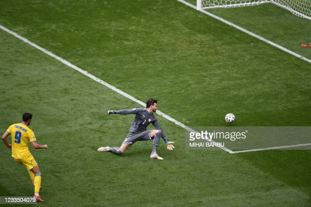 Ukraine's forward Roman Yaremchuk shoots and scores his team's second goal p[ast North Macedonia's goalkeeper Stole Dimitrievski during the UEFA EURO...