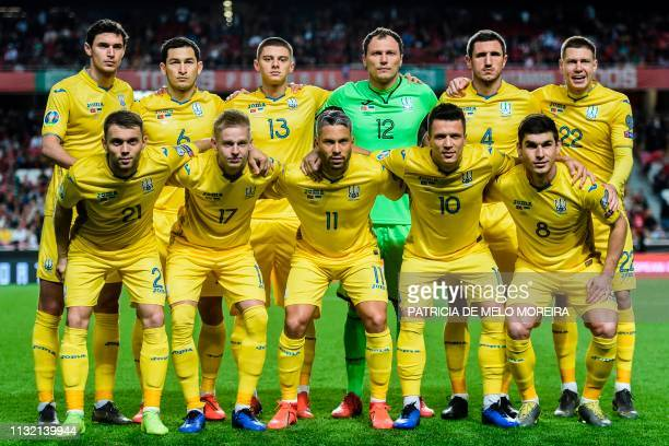 Ukraine's forward Roman Yaremchuk, Ukraine's midfielder Taras Stepanenko, Ukraine's defender Vitaliy Mykolenko, Ukraine's goalkeeper Andriy Pyatov,...