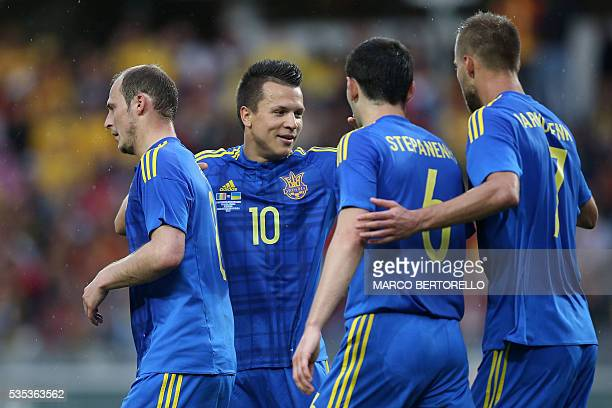 Ukraine's forward Roman Zozulya celebrates with teammates after scoring during the international friendly football match between Romania and Ukraine...