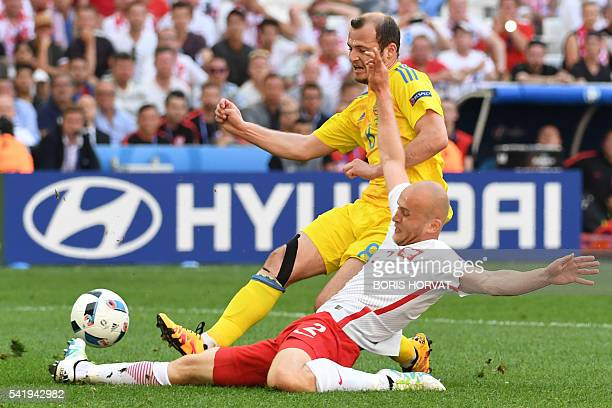 Ukraine's forward Roman Zozulya vies for the ball with Poland's defender Michal Pazdan during the Euro 2016 group C football match between Ukraine...