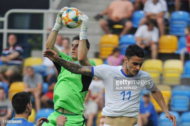 Ukraine's goalkeeper Andriy Lunin vies for the ball with Italy's Gianluca Scamacca during the U20 semifinal football match Ukraine against Italy in...