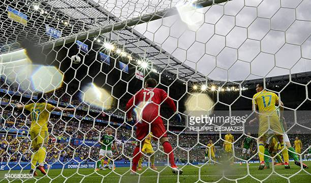 Ukraine's goalkeeper Andriy Pyatov eyes the ball during the Euro 2016 group C football match between Ukraine and Northern Ireland at the Parc...
