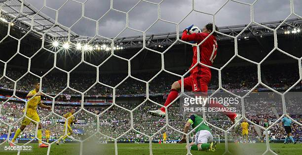 Ukraine's goalkeeper Andriy Pyatov grabs the ball during the Euro 2016 group C football match between Ukraine and Northern Ireland at the Parc...
