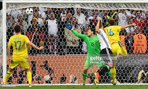TOPSHOT Ukraine's goalkeeper Andriy Pyatov looks at the ball going into his net during the Euro 2016 group C football match between Germany and...