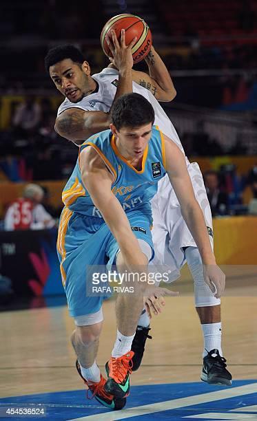 Ukraine's guard Sviatoslav Mykhailiuk vies with New Zealand's guard Corey Webster during the 2014 FIBA World basketball championships group C match...