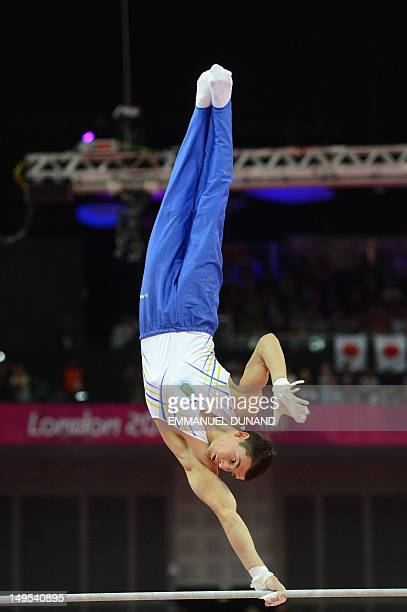 Ukraine's gymnast Mykola Kuksenkov competes at the horizontal bar during the men's team final of the artistic gymnastics event of the London Olympic...