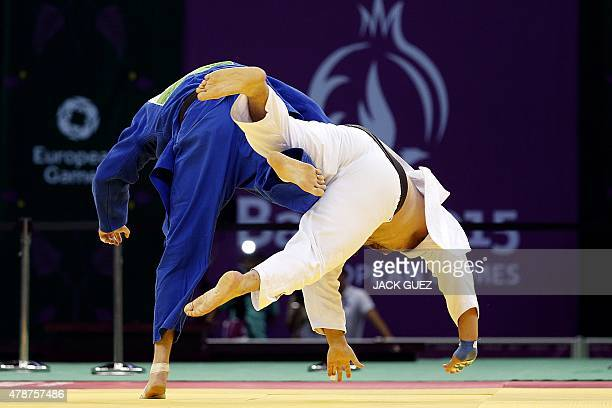 Ukraine's Iakiv Khammo challenges Lithuania's Marius Paskevicius during the men's 100kg judo bronze medal match at the 2015 European Games in Baku on...