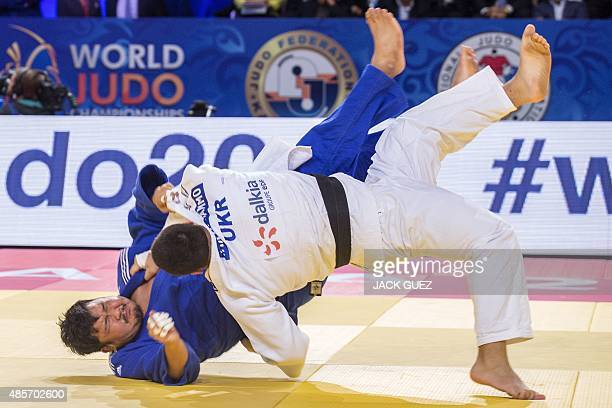 Ukraines Iakiv Khammo competes with South Koreas Kim SungMin during the mens bronze medal match in the 100kg category at the Judo World Championships...