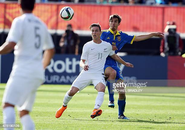 Ukraines Ihor Kharatin competes for the ball against New Zealand's Matthew Ridenton during FIFA's Under20 World Cup's first football match between...