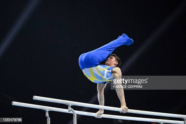 Ukraine's Illia Kovtun competes in the parallel bars competition during the Men's all-around final of the 2021 European Artistic Gymnastics...