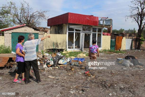 Ukraines Interim Interior Minister Arsen Avakov and press members inspect wreckage of buildings after the clashes in Semenovka near east Ukraines...