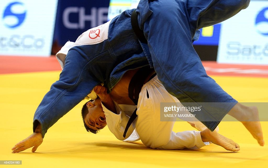 Ukraine's judoka Georgii Zantaraia (white) competes with Japan's Kengo Takaichi during the under 66 kg category competition for bronze medal at the IJF World Judo Championship in Chelyabinsk on August 26, 2014.