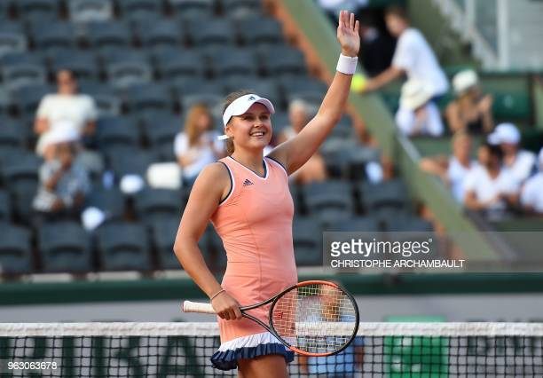 Ukraine's Kateryna Kozlova celebrates after victory against Latvia's Jelena Ostapenko at the end of their women's singles first round match on day...