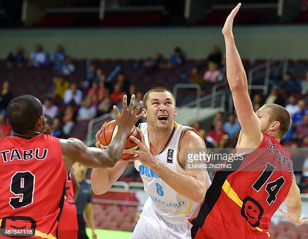 Ukraine's Kyrylo Fesenko tries to score during the Eurobasket 2015 group D basketball match Ukraine vs Belgium in Riga on September 10 2015 AFP PHOTO...