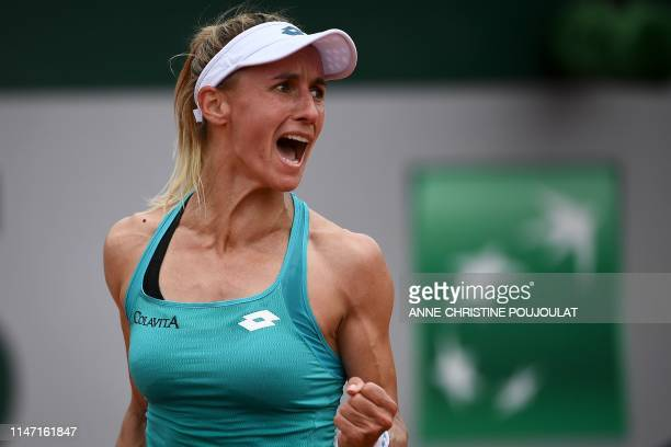 Ukraine's Lesia Tsurenko celebrates after winning against Serbia's Aleksandra Krunic after winning their women's singles third round match on day six...