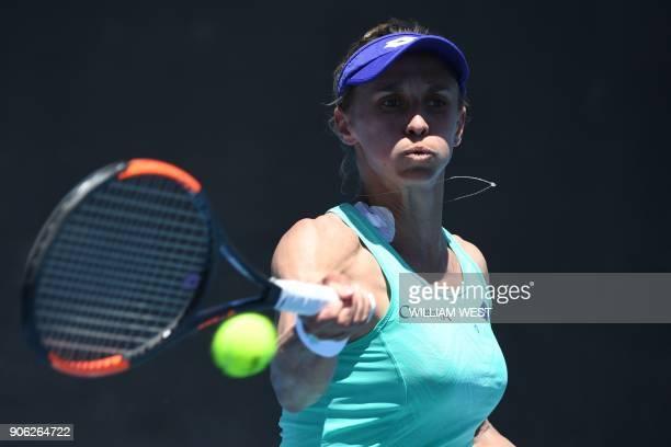 Ukraine's Lesia Tsurenko hits a return against Poland's Agnieszka Radwanska during their women's singles second round match on day four of the...