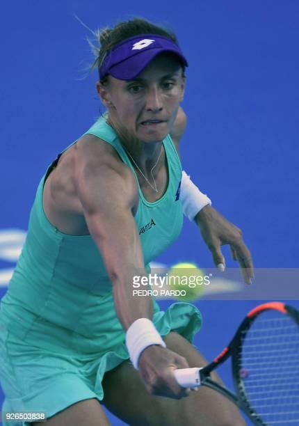 Ukraine's Lesia Tsurenko returns the ball to Australia's Daria Gavrilova during their Mexico WTA Open women's singles semifinal tennis match in...