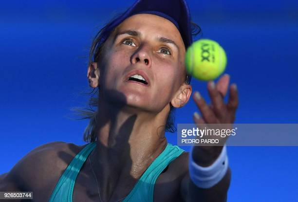 Ukraine's Lesia Tsurenko serves to Australia's Daria Gavrilova during the Mexico WTA Open women's singles semifinal tennis match in Acapulco Guerrero...