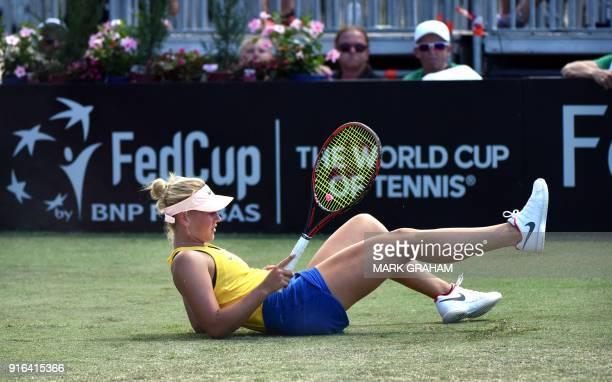 Ukraine's Marta Kostyuk falls down during play against Australia's Daria Gavrilova in their women's singles Federation Cup tennis match in Canberra...