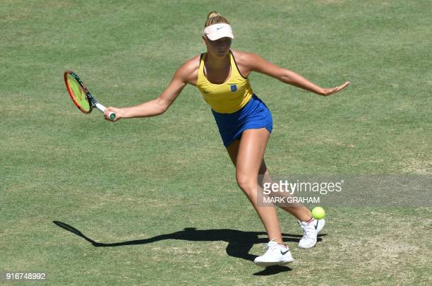 Ukraine's Marta Kostyuk hits a return against Australia's Ashleigh Barty in their women's reverse singles Federation Cup tennis match in Canberra on...