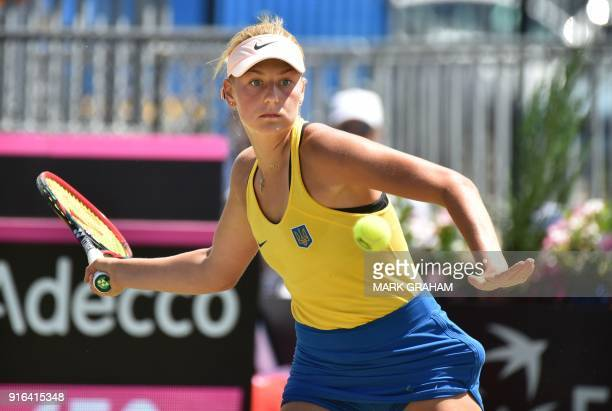 Ukraine's Marta Kostyuk hits a return against Australia's Daria Gavrilova during their women's singles Federation Cup tennis match in Canberra on...