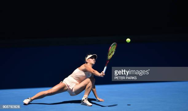 Ukraine's Marta Kostyuk hits a return against Australia's Olivia Rogowska during their women's singles second round match on day three of the...