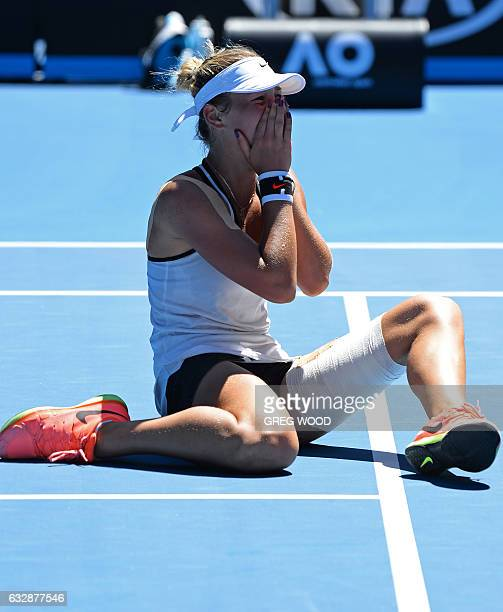 Ukraine's Marta Kostyuk is overcome with emotion after defeating Rebeka Masarova of Switzerland in the junior girl's singles final on day 13 of the...
